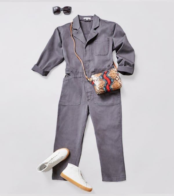 White sneakers with a gray loose-fit sleeved jumpsuit