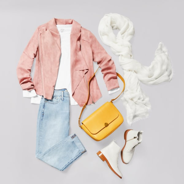 Women's light wash jeans with a long sleeve shirt and pastel blazer