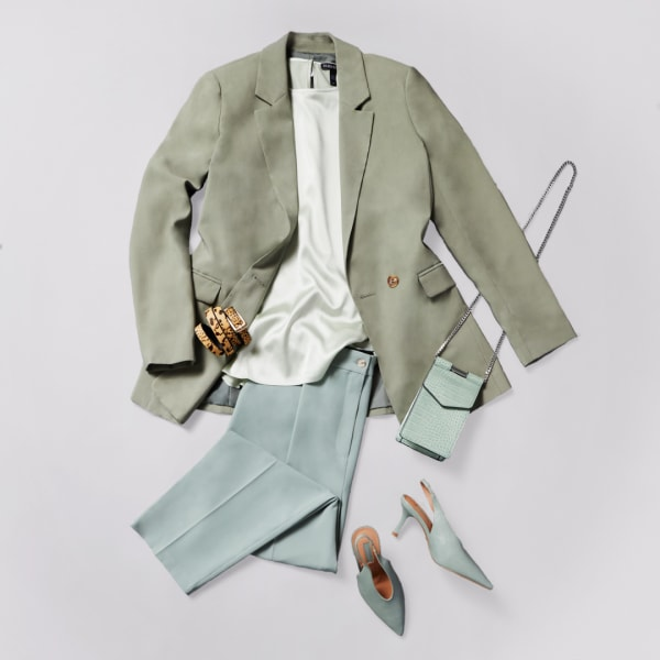 Muted mint green monochromatic pastel blazer paired with a blouse and tapered pants
