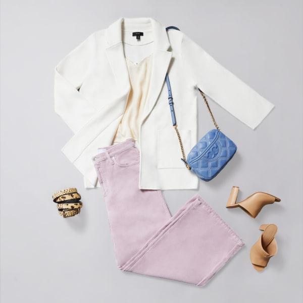 Women's wide leg corduroy pants with a white blazer and powder blue purse