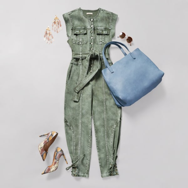 Green women's jumpsuit with heels and a powder blue tote