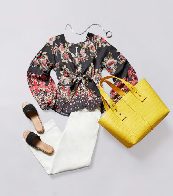 Floral top with white pants and a yellow purse for a pop of color