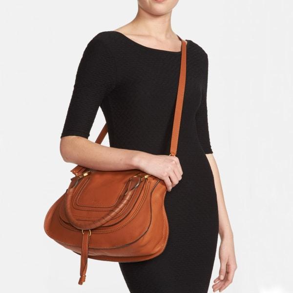 Types of purses: Medium-size brown satchel handbag