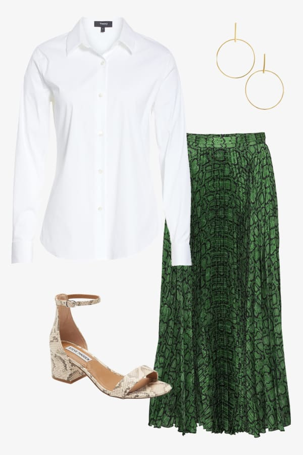 White fitted button down shirt paired with gold hoops and a long green high waisted skirt