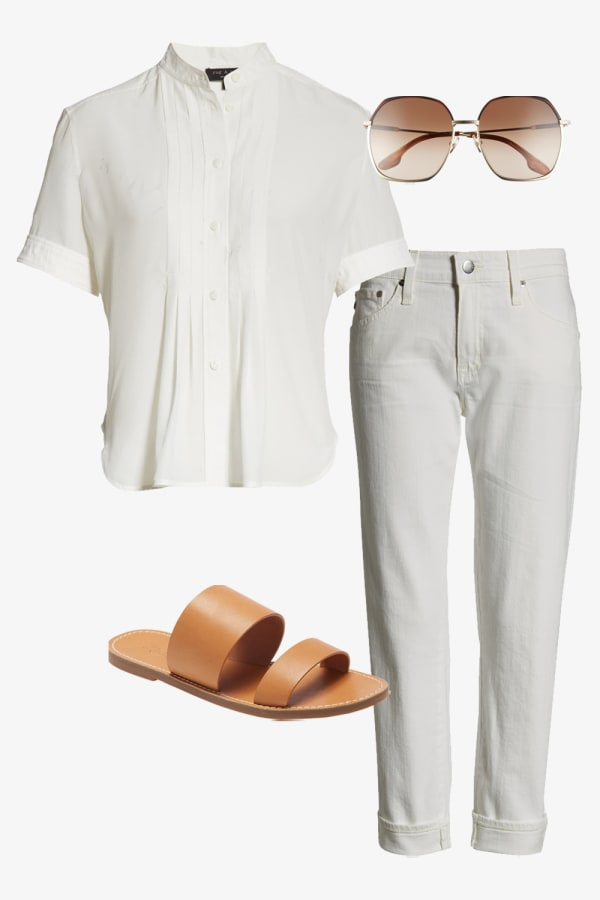 Short sleeve white women's shirt paired with white cuffed jeans and slip on sandals