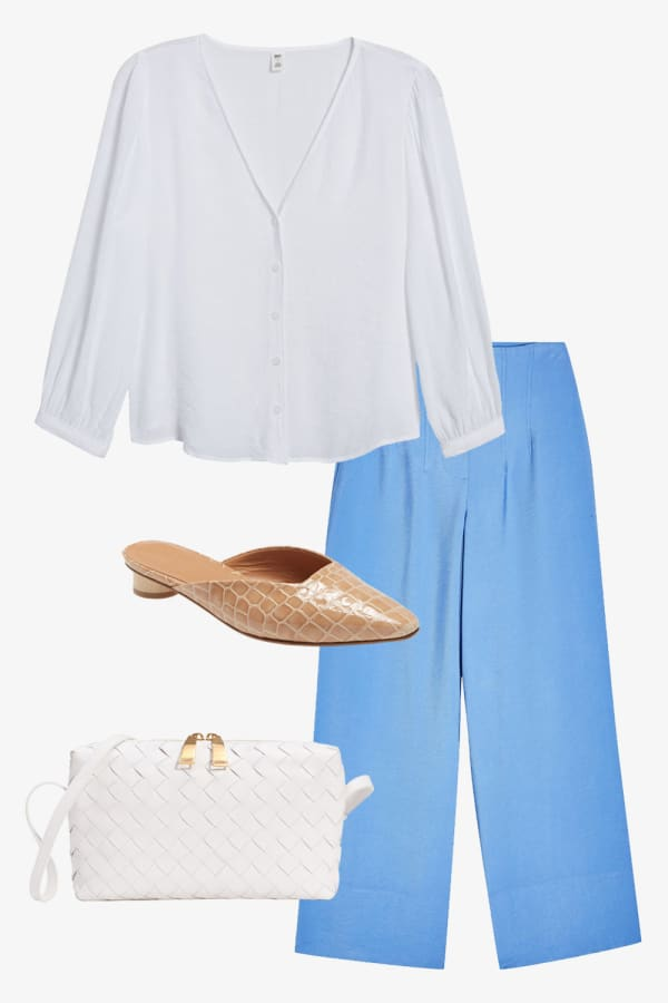 A collarless white blouse with wide leg trousers and tan slip on shoes