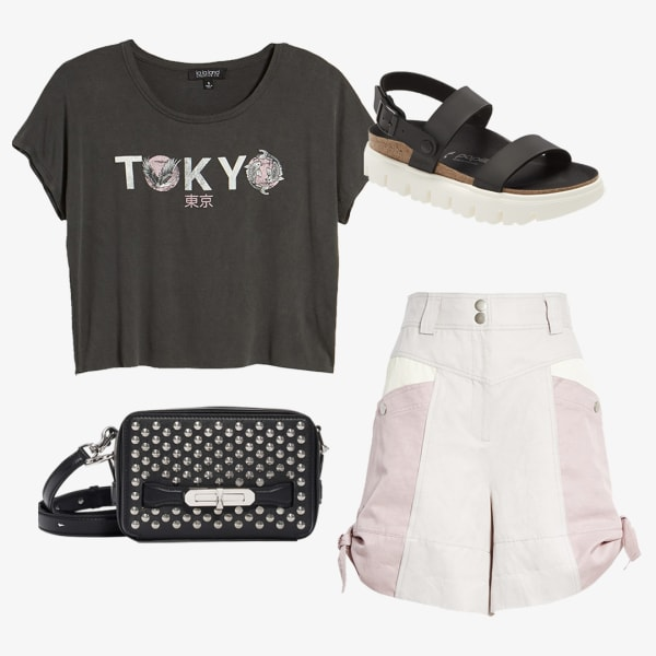 High waisted shorts paired with a black graphic t-shirt and sandals