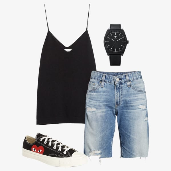 Women's ripped denim bermuda shorts, black tank top and sneakers with a