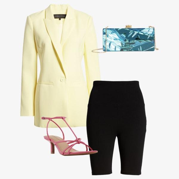 Black biker shorts with a long yellow blazer and a eye catching blue purse