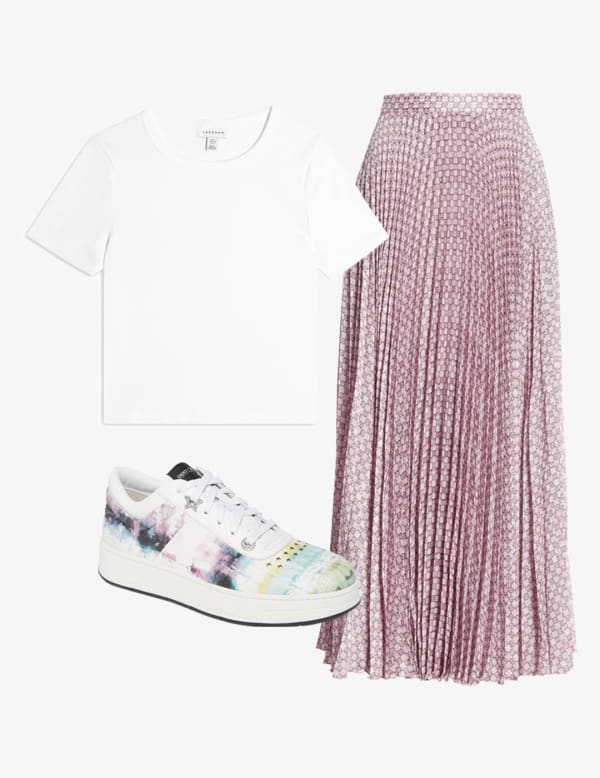 Pink shiny pleated skirt outfit with a white t-shirt and sneakers