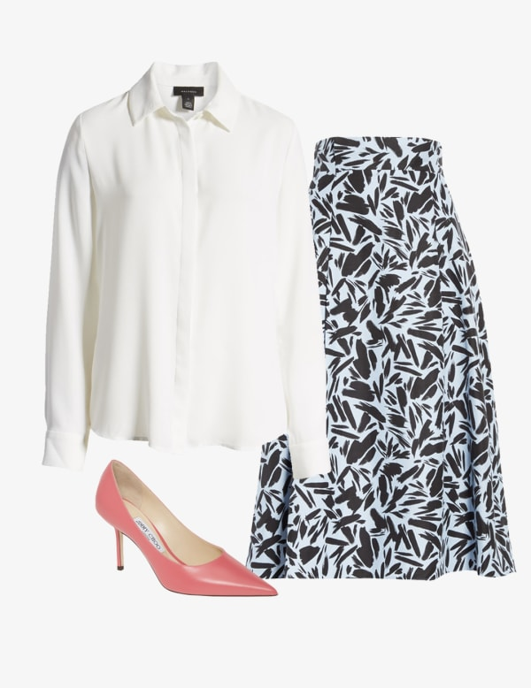 Women's a-line skirt with a collared white blouse and pointed toe pumps