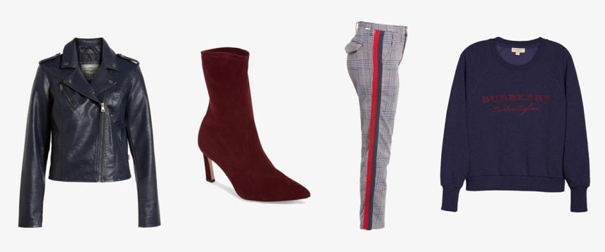 Navy leather jacket and sweatshirt, red bootie, and red and blue pants