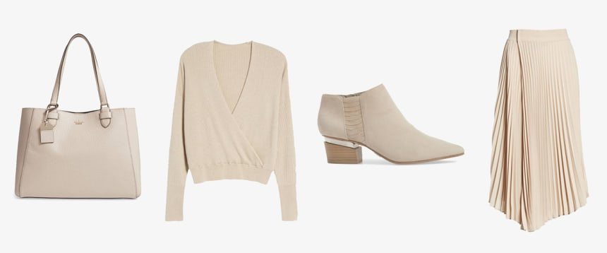 Oatmeal colored tote bag, sweater, bootie, and skirt
