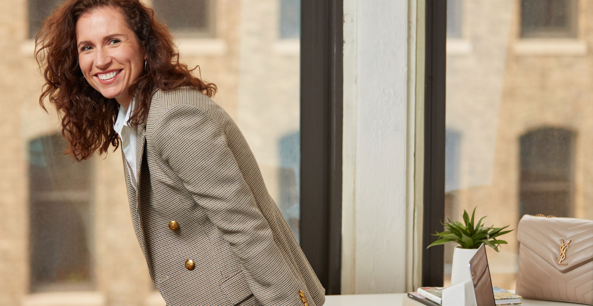 business woman in houndstooth blazer