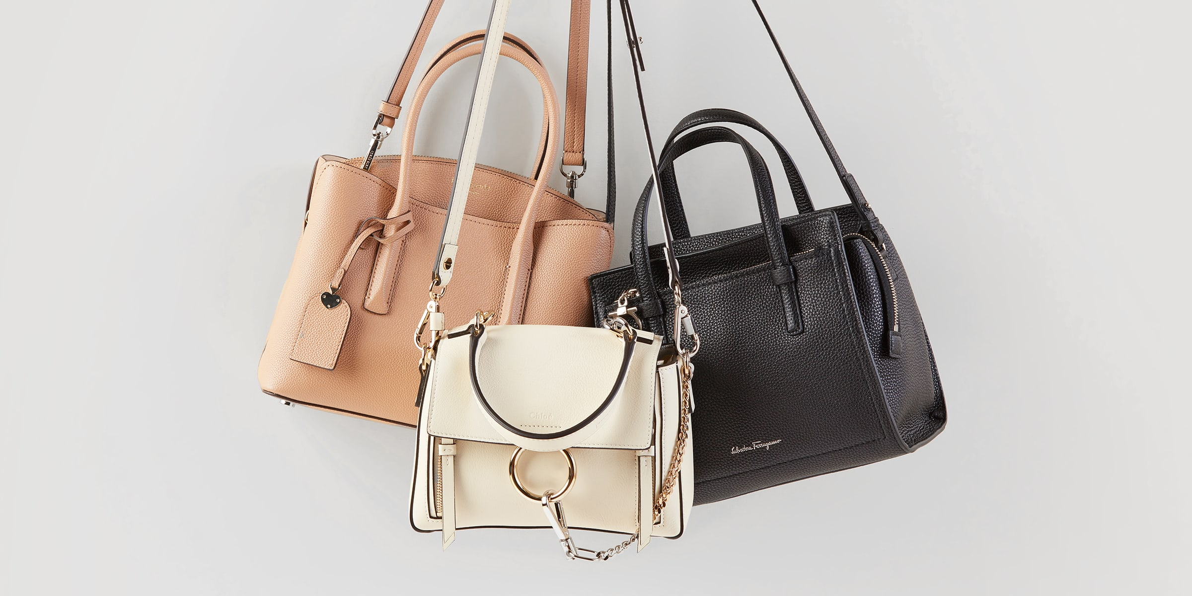 Different types of purses in neutral tones