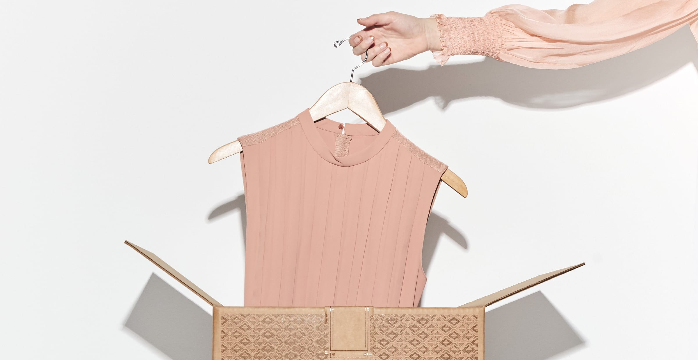 Removing a pink blouse from a trunk