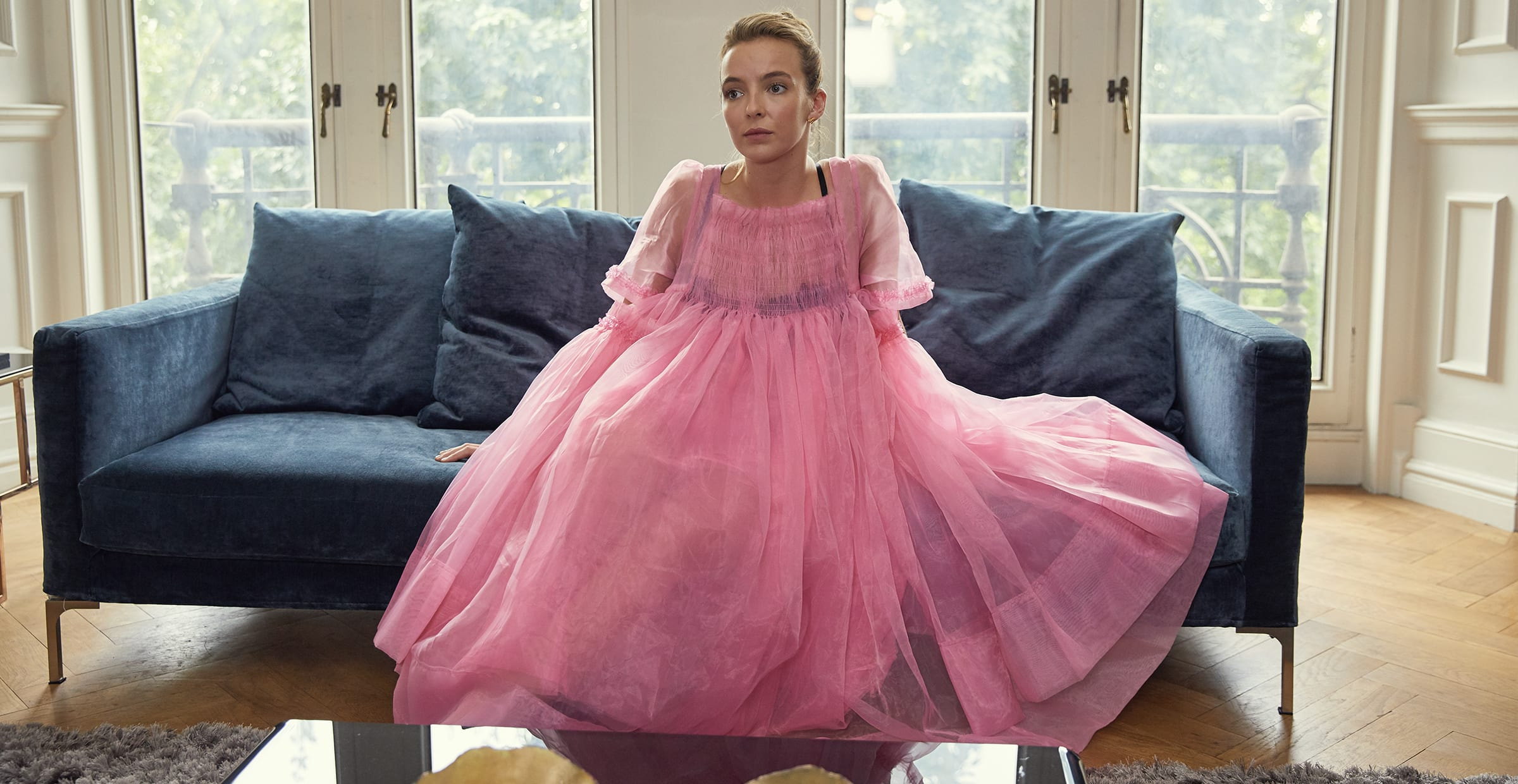 "Jodie Comer wearing a pink dress as Villanelle in ""Killing Eve"""