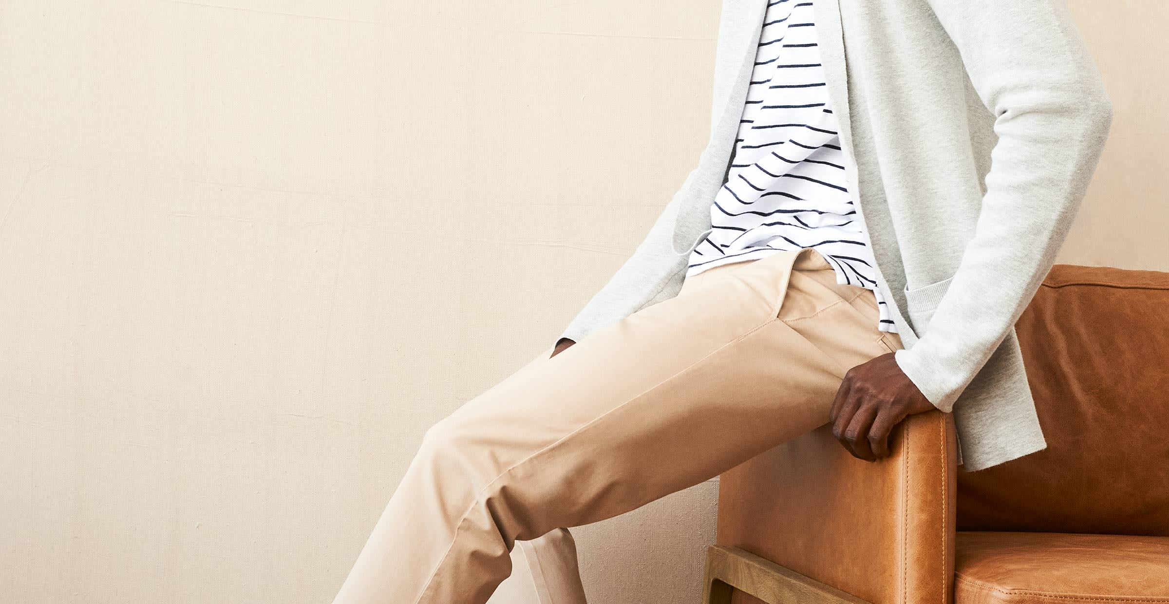 Classic Men's style includes cable knit sweater and chinos