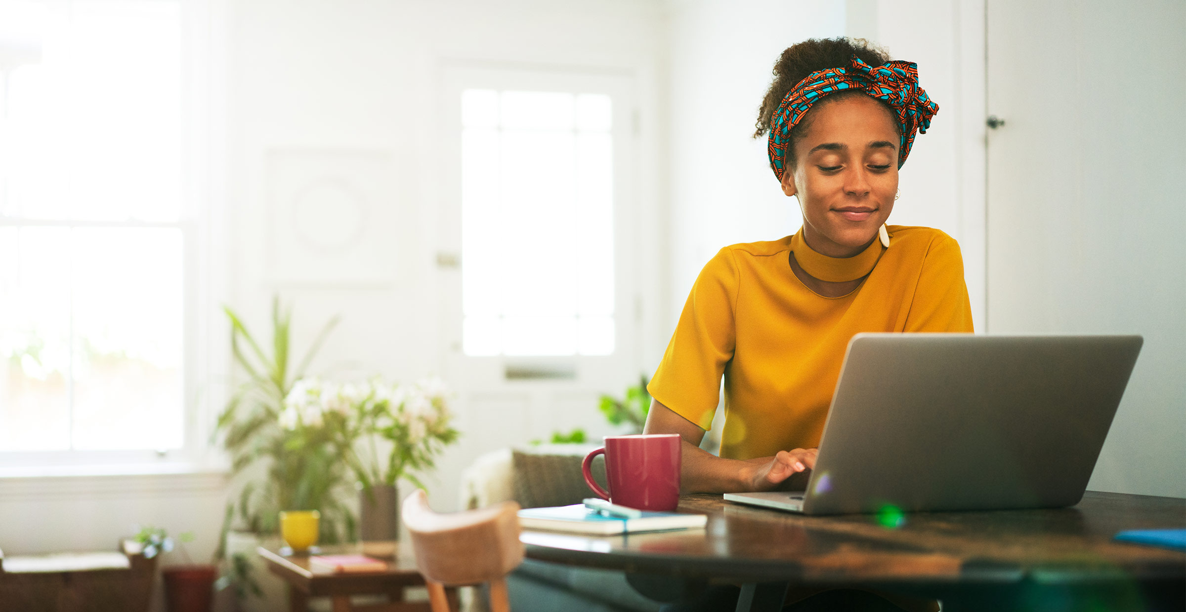 Woman working from home at her computer