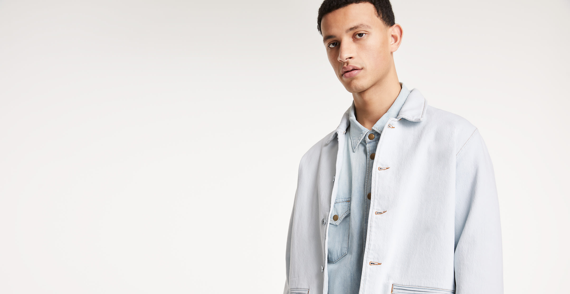 man wearing denim jacket, button-up and jeans