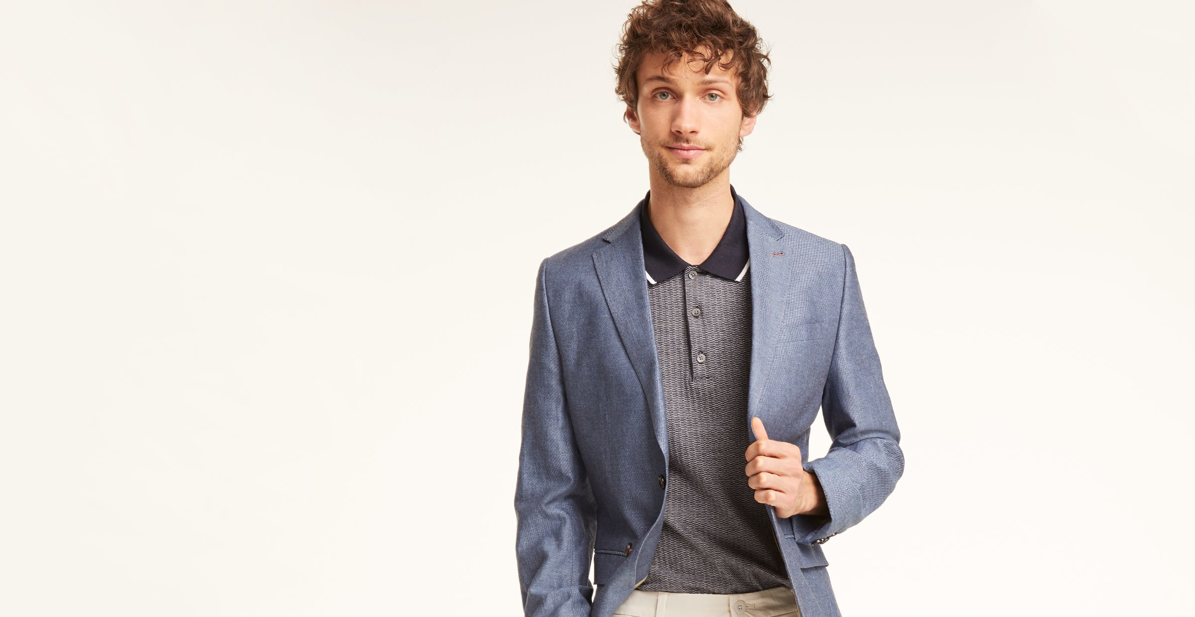 A Man in a preppy outfit: Blazer and button down t-shirt