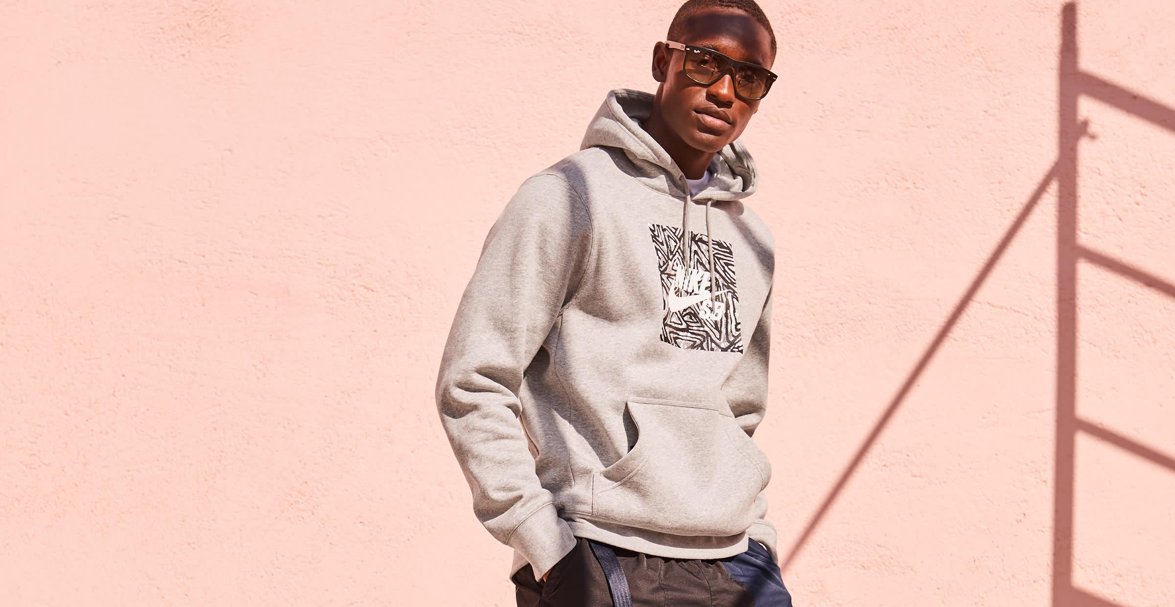 Man in a gray hooded sweat shirt