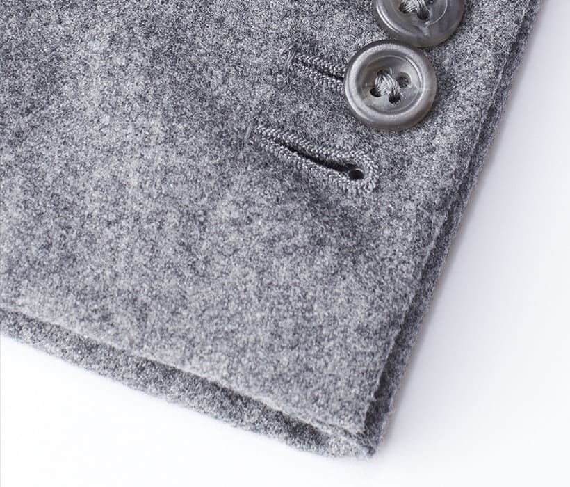 Functional sleeve buttons—with one left undone, as per custom traditions