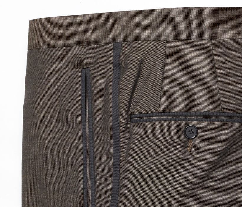 Formal grosgrain treatment for side seams, pockets, and waistbands (not shown)