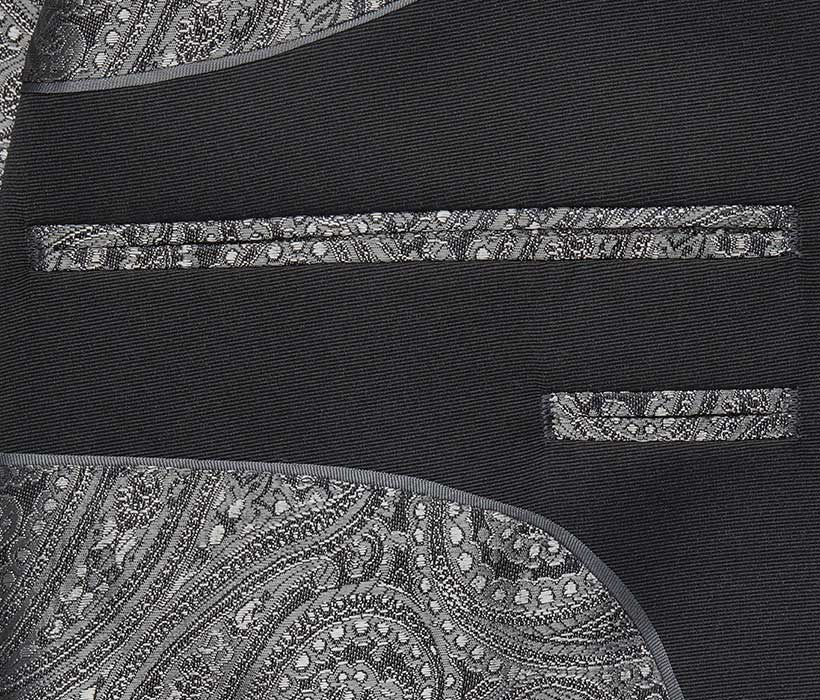 Curved French facing joins lapel fabric to lining with exquisite piping