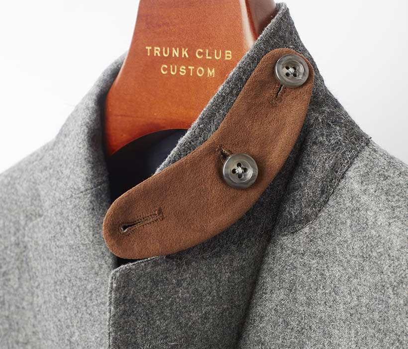 Removable microsuede collar tab