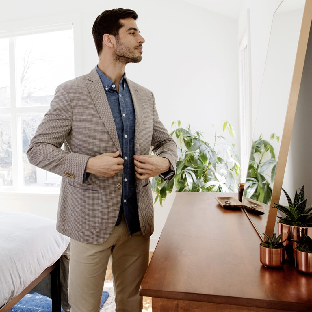Man getting dressed in business casual attire