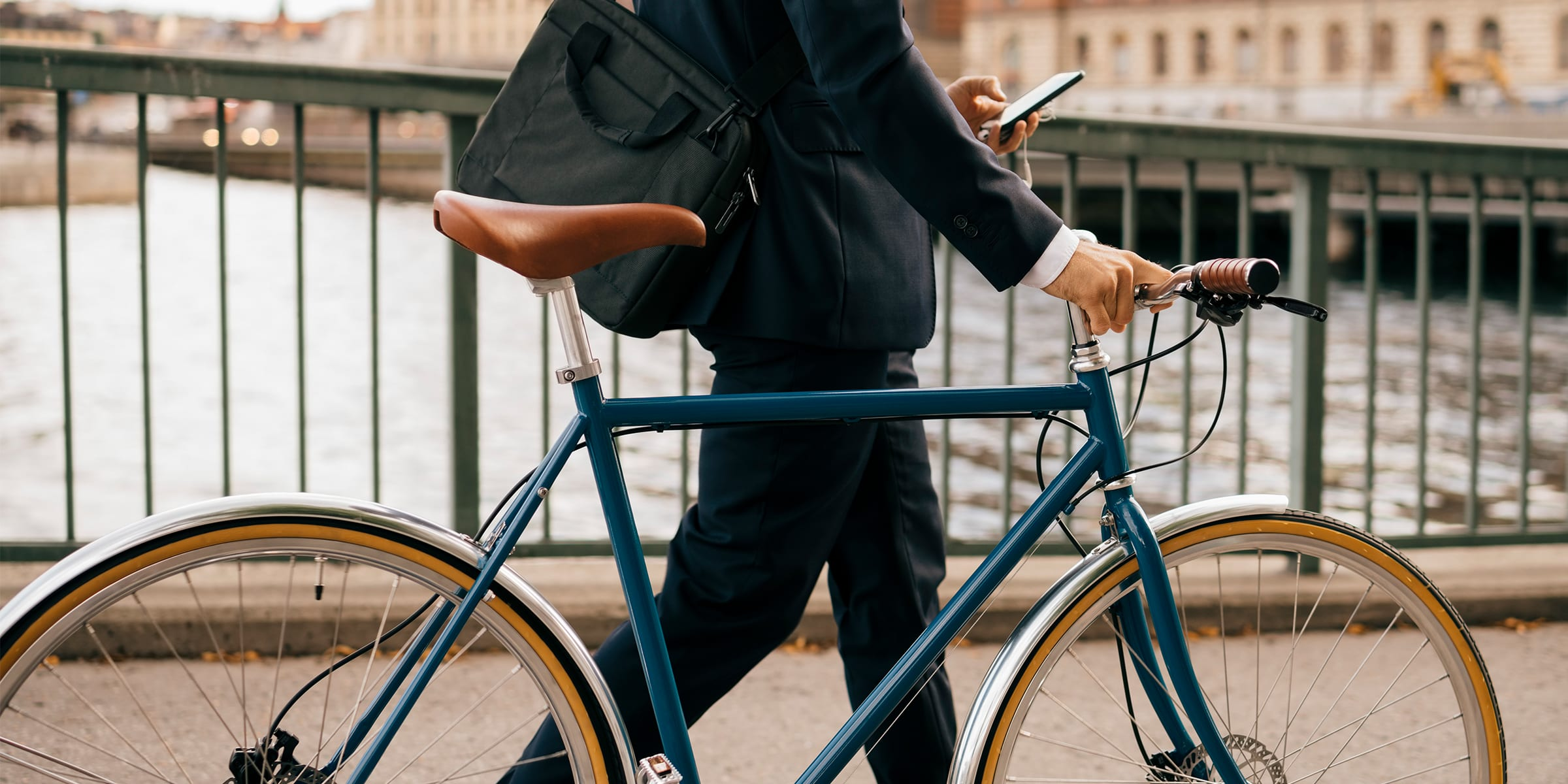 A man riding a bike to work instead of driving