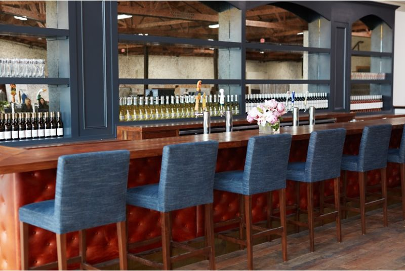 Trunk Club clubhouses feature fully stocked bars with drinks on the house