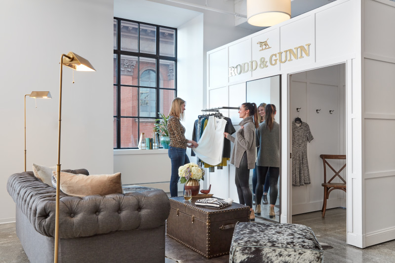 Trunk Club Boston Women's Fitting Room with styling helping female member