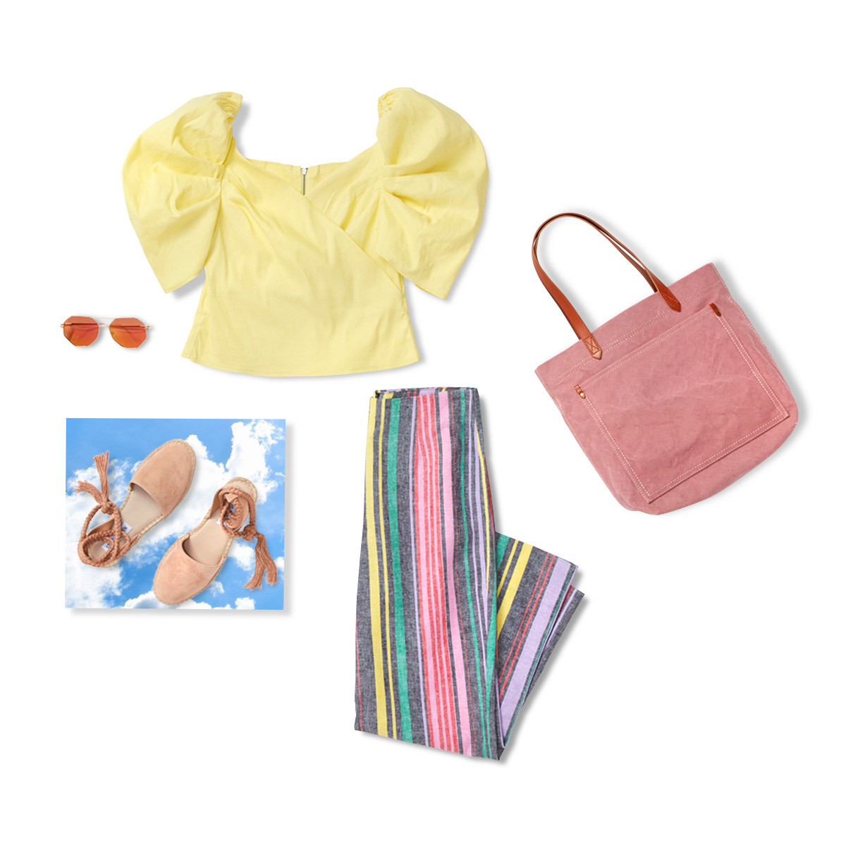 Yellow top, striped pants, sunglasses, pink suede bag and nude sandals laid flat on a white background.