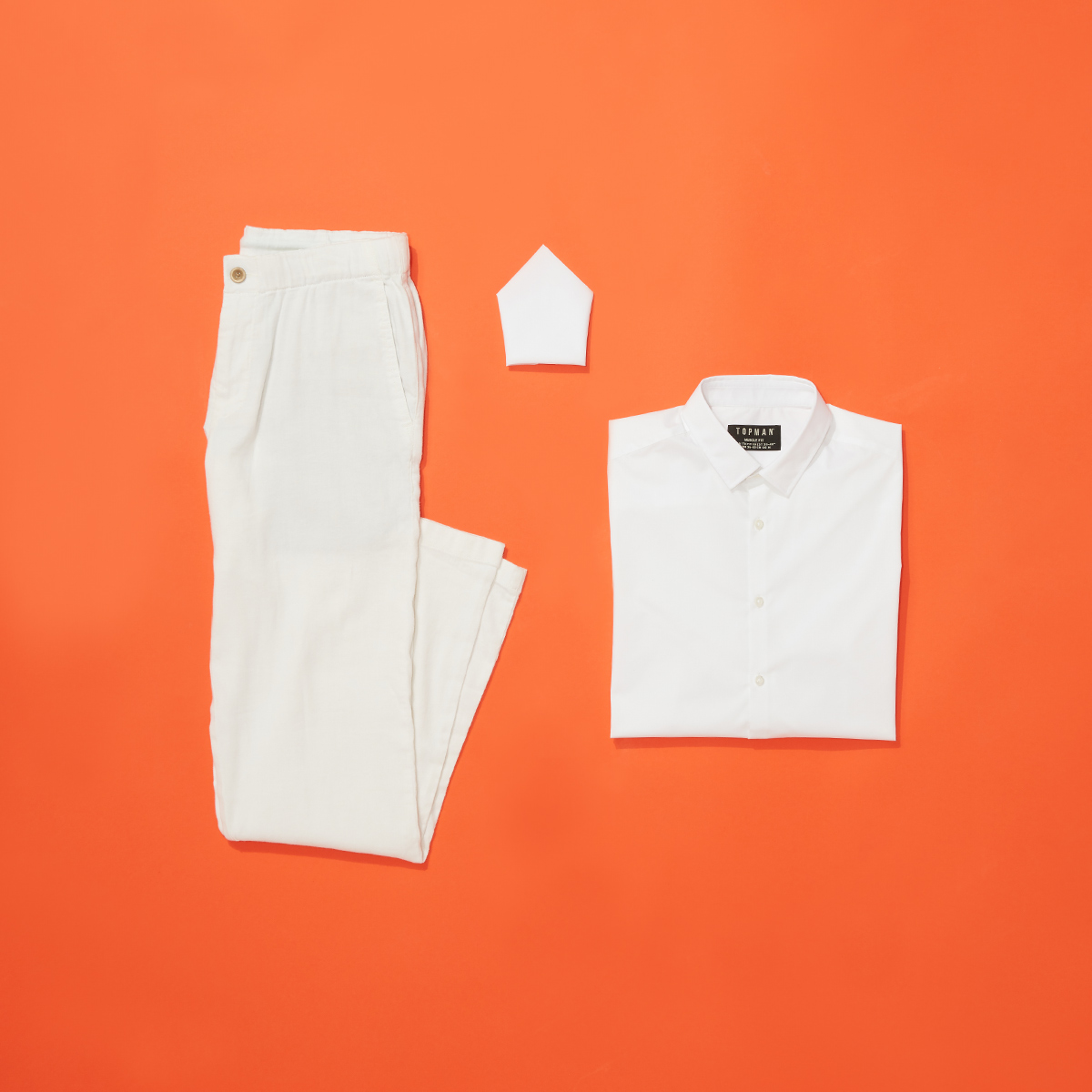white collared shirt, white jeans and a white handkerchief