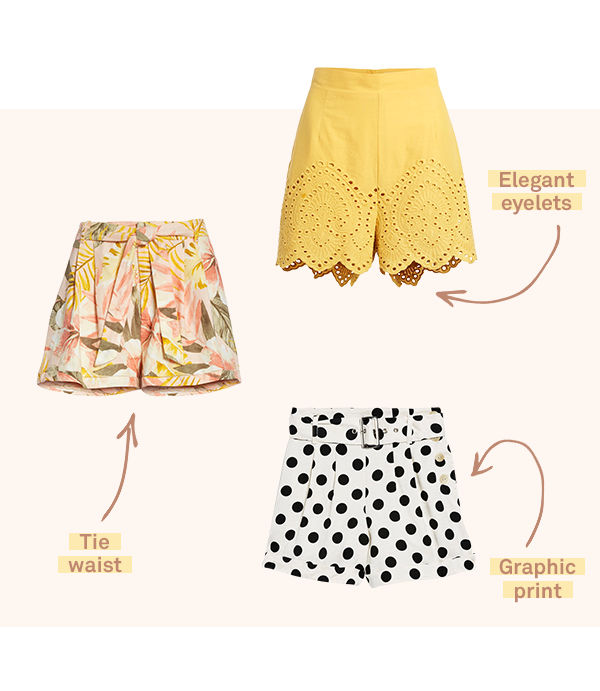 Three pairs of women's shorts in various patterns and colors laid flat on a light pink background.