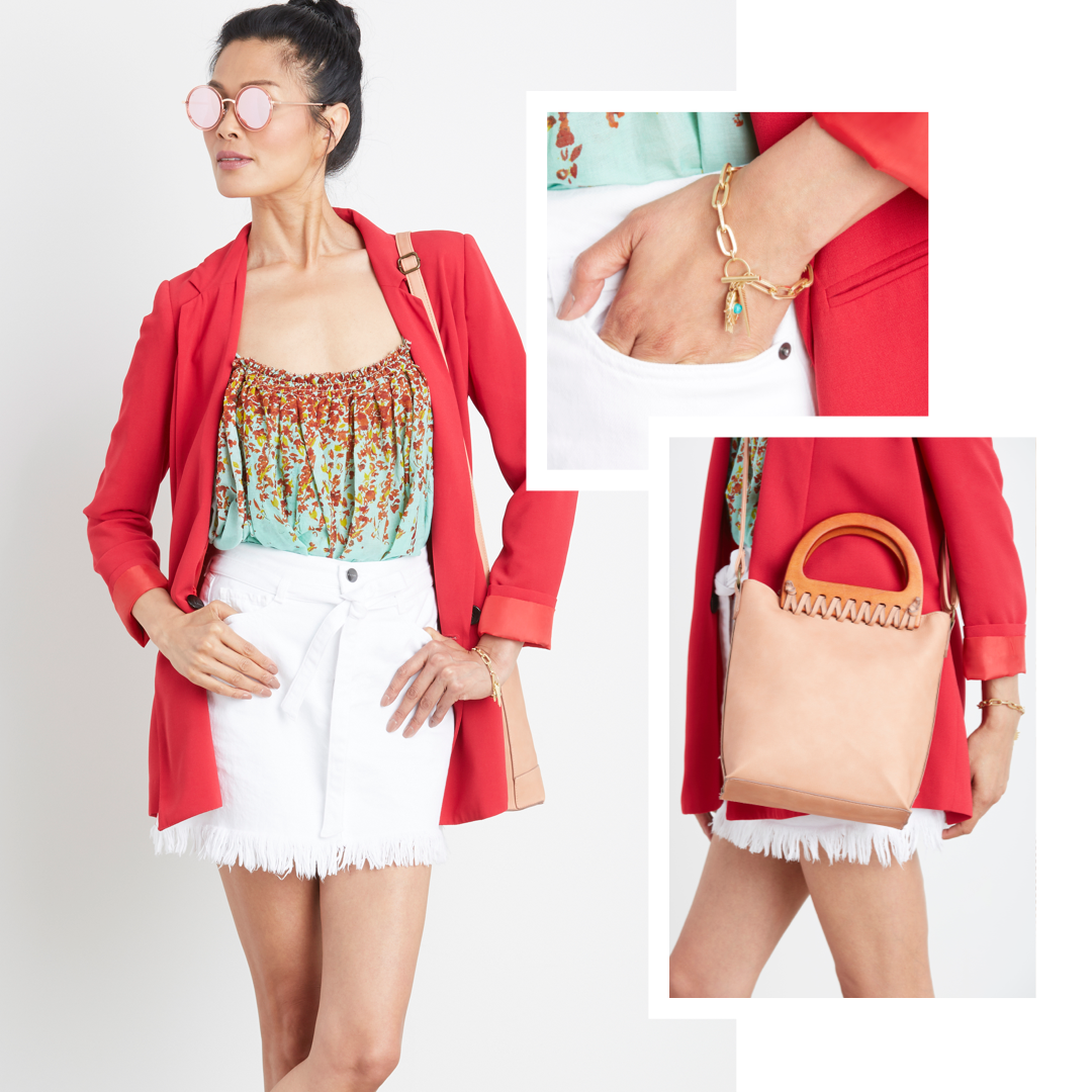 A red blazer with a white skirt.