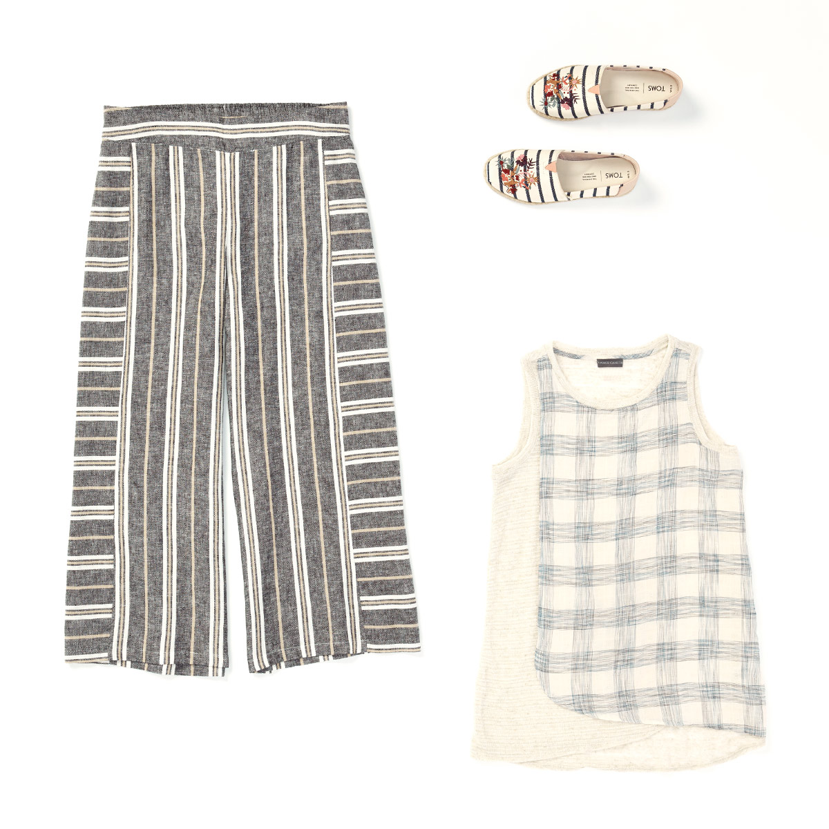 A patterned women's tank, pair of slacks and pair of sneakers laid flat on a white background.