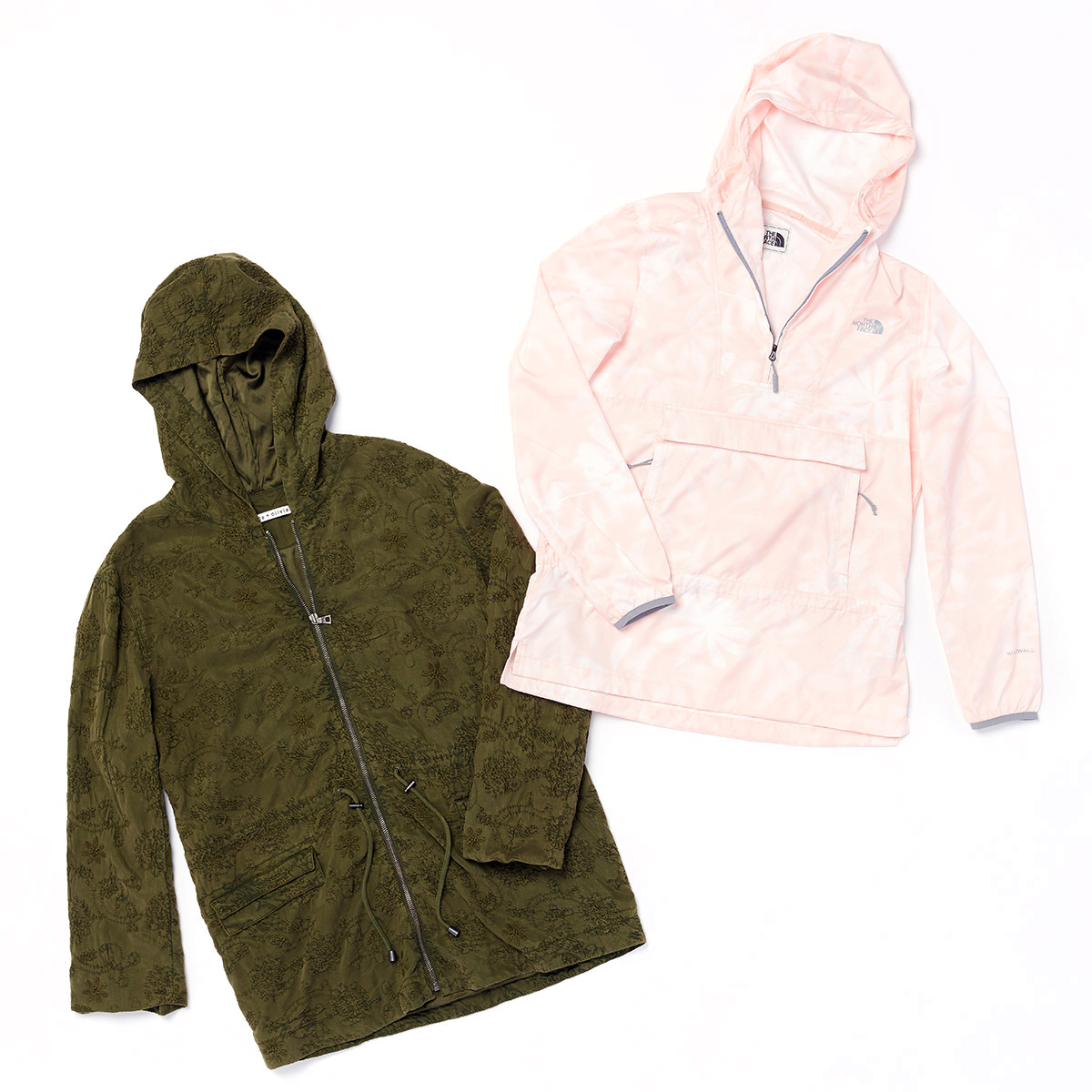 Two women's parkas - one green and the other a light patterned pink - laid flat on a white background.