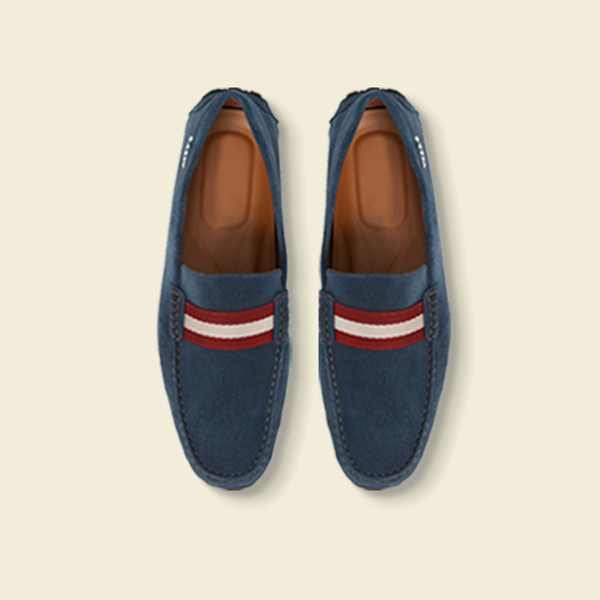 Navy driving shoes with a red stripe.