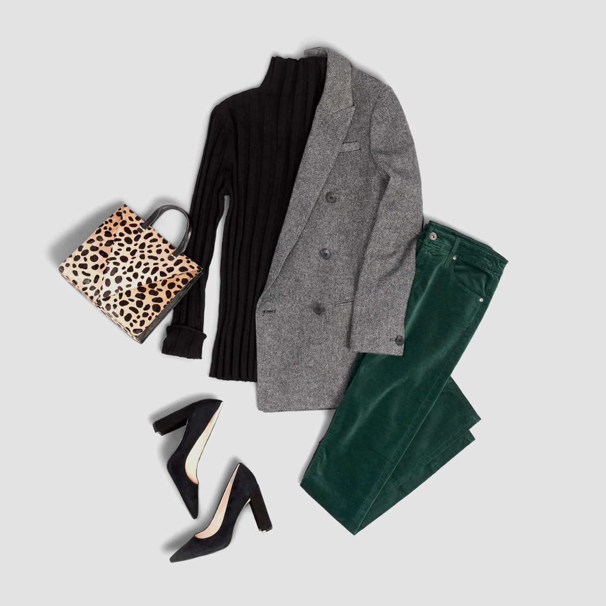 Women's outfit featuring green velvet pants.