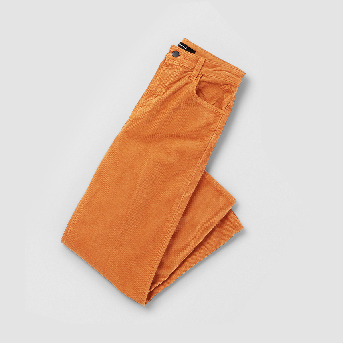 Women's outfit featuring orange corduroy pants.