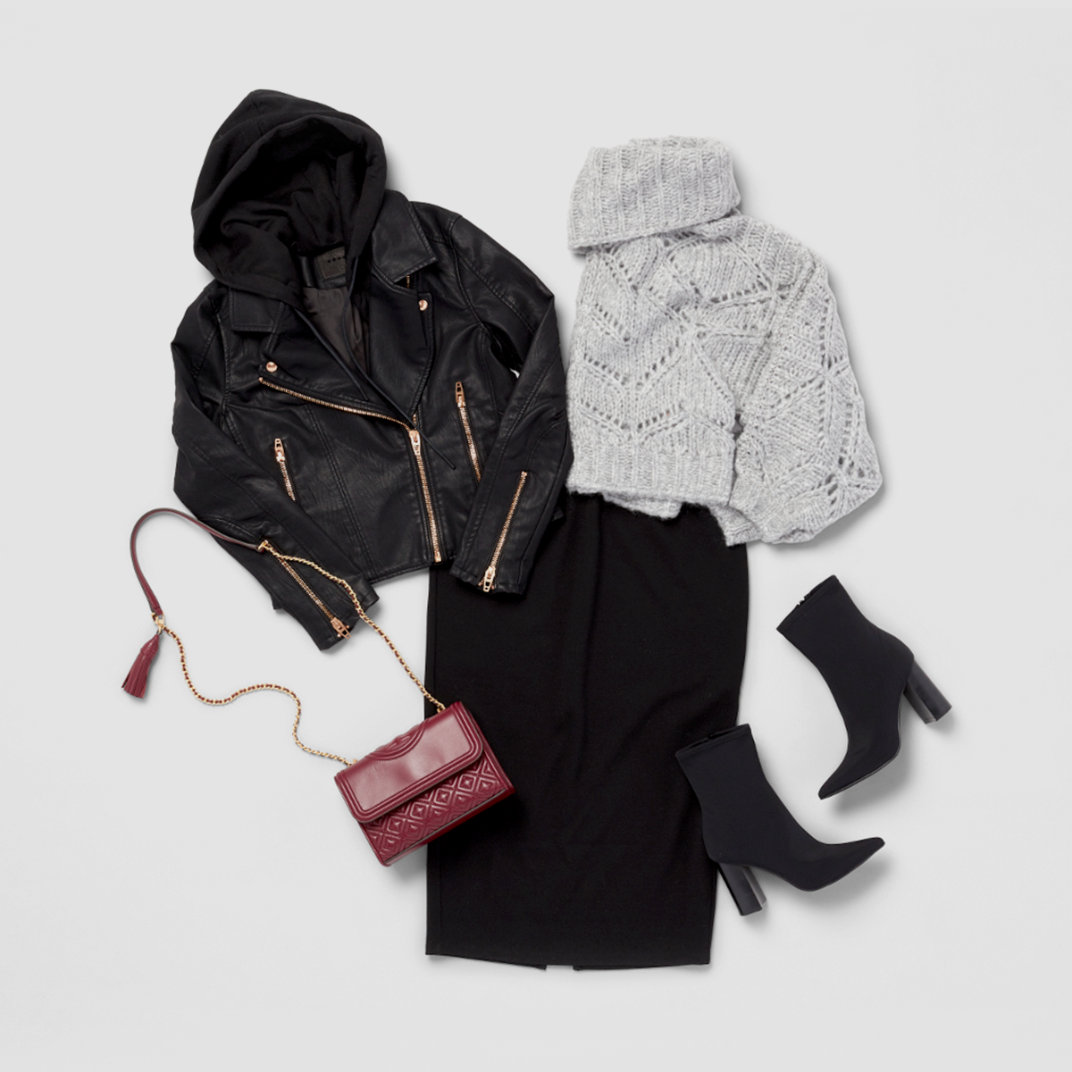 Women's outfit featuring a grey cowl-neck wool sweater.