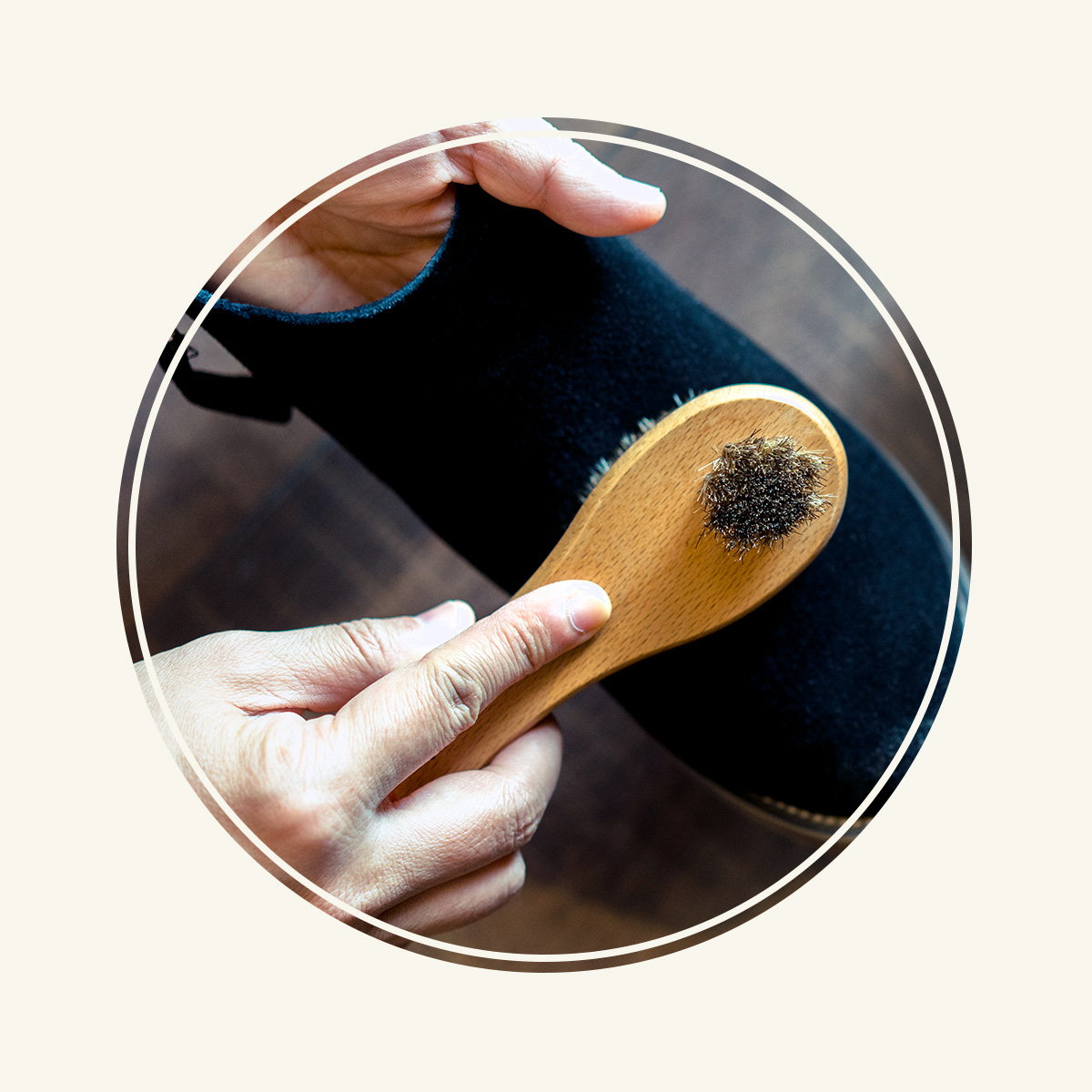 Man brushing a suede boot.