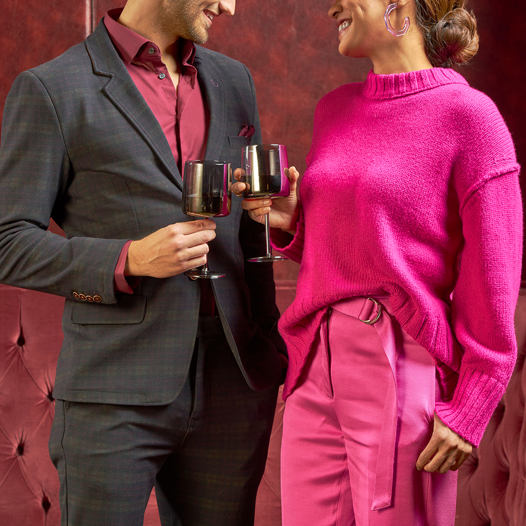 Couple having drinks in formalwear.