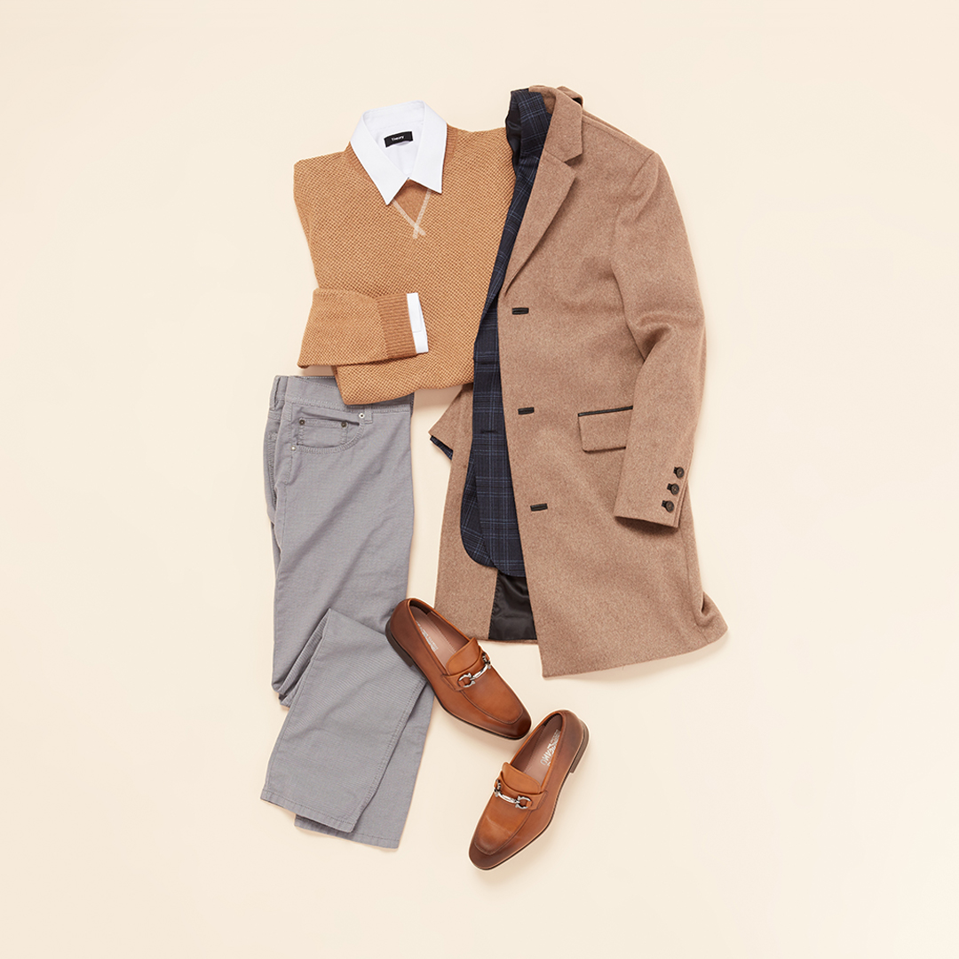 Tan coat with grey slacks.