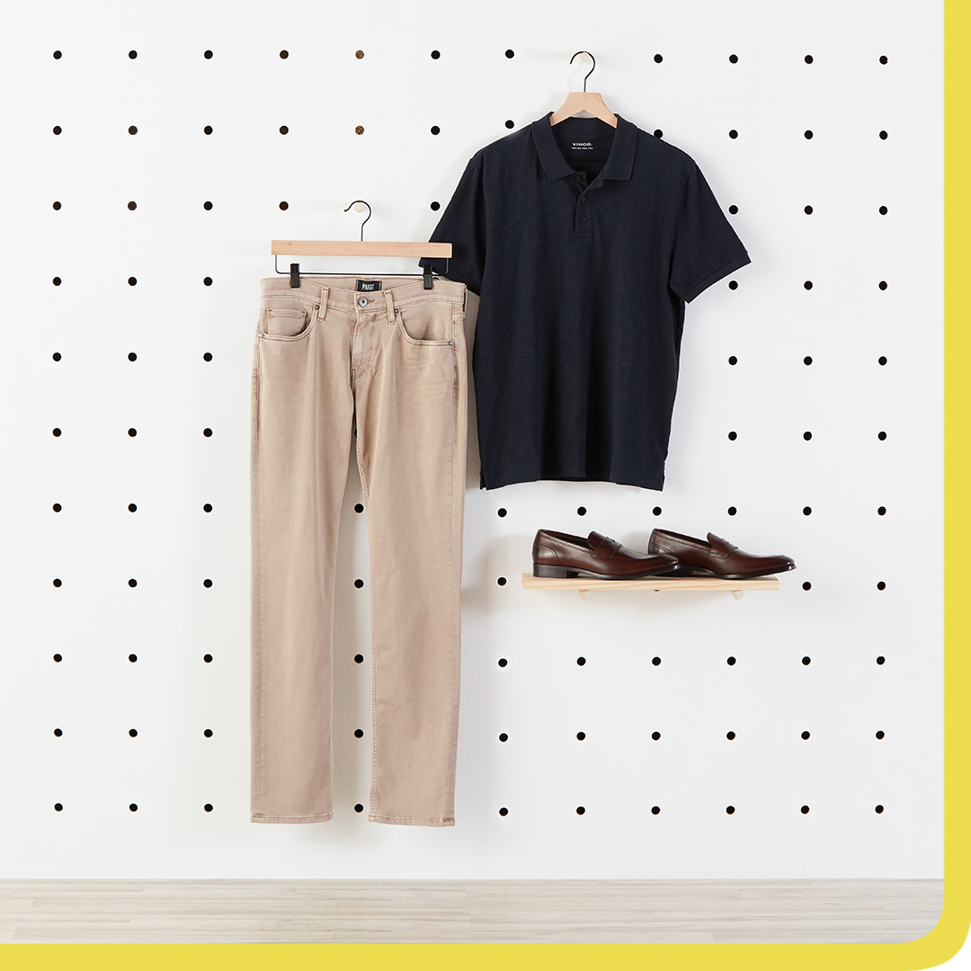Navy polo, chinos, and brown shoes.