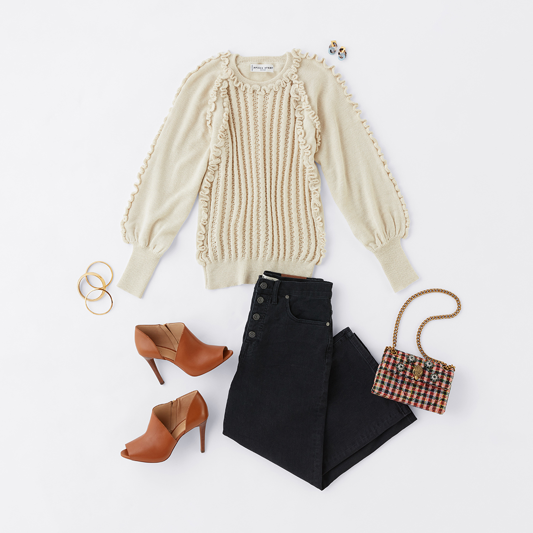 Women's ruffle sweater and jeans outfit