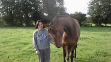 Emma checking a friends horse. 2017